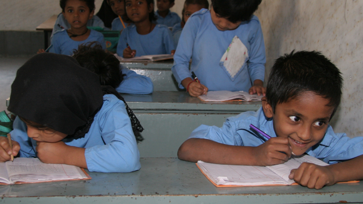 A Child in india smiles in school